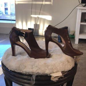 Louise eat Cie brown heels with black buckle